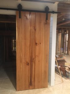 Vertical Cherry Barn Door at The Horse Shoe Farm Made of wood from The Lodges at Eagles Nest