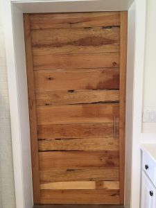 Horizontal Cherry Barn Door at The Horse Shoe Farm Made of wood from The Lodges at Eagles Nest