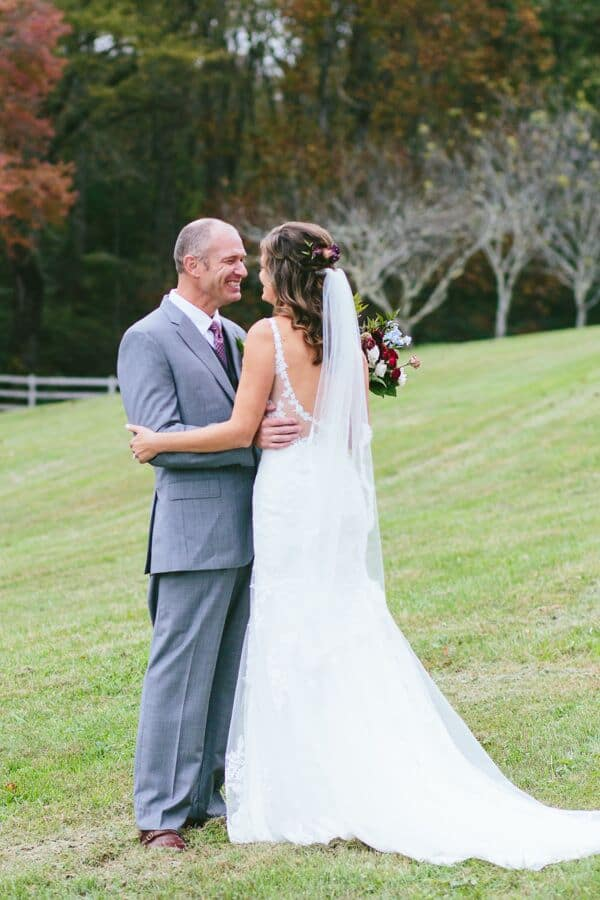 A bride and groom seeing each other for the first time during their fall wedding.